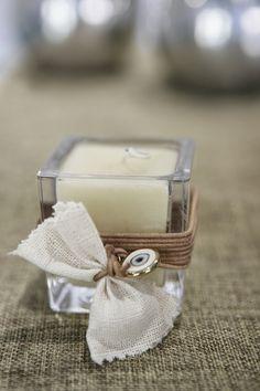 μπομπονιερα κερι με διακοσμητικο επιχρυσο ματι δεμενο με δερμα