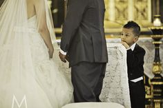 Amazing shot. Kudos to the photographer. The ring bearer is in complete admiration haha. And if I'm not mistaken, he is wearing a snazzy tailcoat suit. Love it! Two snaps