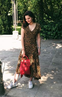 The red Hawk backpack is an essential day-to-day accessory, which you can take to work, but also after hours. Here, paired up with an animal print maxi dress, it provides an interesting and eye-catching contrast. Space Fashion, Fashion Line, Animal Print Maxi Dresses, After Hours, Color Pop, Contrast, Backpack, Short Sleeve Dresses, Pairs