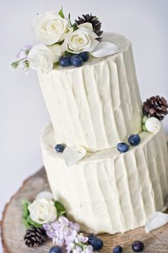Smart buttercream 2 tiered wedding cake with fresh berries and flowers. Lovely for a barn wedding