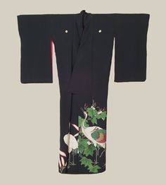 Kurotomesode, Late-Meiji era (1890-1911). A large and striking crepe-silk antique kurotomesode featuring elegant cranes and paulownia masterfully created with yuzen-dyeing, sagara knot and simple embroidery. The Kimono Gallery
