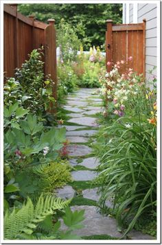 fishtailcottage.blogspot.com - Flagstone pathway.   I think this would work for my backyard entry.