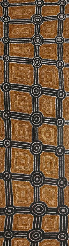 Mick Namarari Tjapaltjarri (circa 1926-1998)  Nyunmanu (Dingo Dreaming)   bears Papunya Tula Artists catalogue number MN830724 on the reverse  synthetic polymer paint on linen  164 x 47cm