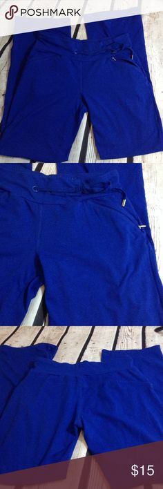 """Danskin Blue Workout or Lounge Wear Sweatpants Sm Like new. No real sign of wear on these pants. They have 2 zippered pockets in the front and a drawstring waist. Size is listed as a small but they run a little on the larger size. Waist is about 29"""" length is about 38.5"""". Color is a little bit darker blue than picture shows. Danskin Pants Track Pants & Joggers"""