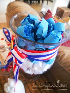 Fill glass jar with rolled paper containing memorabilia or trivia from high school class year