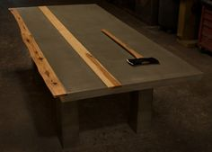 Concrete / Hickory Wood Dining Table. $3,500.00, via Etsy.