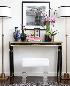 Frame a console table with two floor lamps; it leaves you more room on the table (not that you need that many orchids). Via decorpad.com