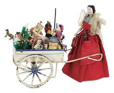 German Porcelain Lady as Toy Peddler with Tin Cart of Miniature Toys, Late 19th century