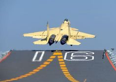 A J-15 fighter takes off from the aircraft carrier Liaoning in June 2014. (Photo/CNS)