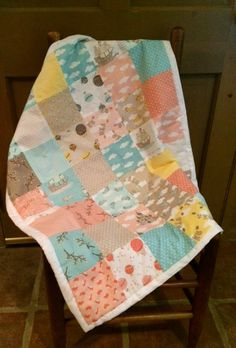 This super soft handmade baby quilt/blanket is perfect for newborns and infants. The front patchwork is made of cotton fabric, backed with