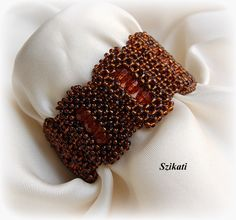 Brown Beaded Cuff Bracelet, Seed Bead Bracelet, Statement Beadwork, CRAW, Bead Jewelry, Unique Gift for Her, OOAK by Szikati on Etsy https://www.etsy.com/listing/127766620/brown-beaded-cuff-bracelet-seed-bead