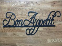 "Bon Appetit Sign Metal Wall Art Home/Restaurant Decor 37"" By 14"" by sayitallonthewall. $54.99. Handmade in the USA - Family Operated Business. We can create names, words, logos and more. High Quality Steel Construction - Will not warp like vinyl. Custom Orders Available to Match This Font!!!. Measures: 37"" Wide By 14"" Tall. Metal Wall Art Decor Bon Appetit Words, Hand Made in the USA from High Quality Steel. Painted In New Condition.   Check out my other items! Be sure to..."