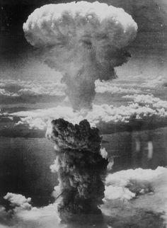 """""""A dense column of smoke rises more than 60,000 feet into the air over the Japanese port of Nagasaki, the result of an atomic bomb, the second ever used in warfare, dropped on the industrial center August 8, 1945, from a U.S. B-29 Superfortress."""" 208-N-43888."""