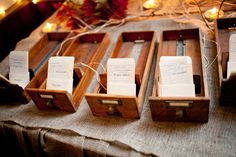 instead of table numbers we had book names, and escort cards were library check out cards. one of my favorite details of our wedding.   photography by @Robb Davidson