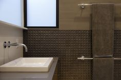 Great #bathroom #details in this shot.  The recessed patterned tile, along with modern bath fixtures create a harmonious blend of materials. #architecture #interiordesign  Photo Credit: Paul Dyer Photography