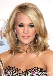 This is what my haircut was SUPPOSED to look like. Saving this for when it's long enough to get it fixed!