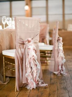 wedding chair ruffles. They are circle ruffles - just cut out a circle of material and then cut around the circle in a spiral shape. they should be twice the length of the back of the chair. demonstration here: http://www.easyknoxweddings.com/diy/paper-flowers/