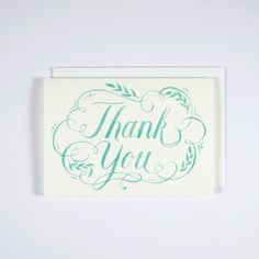 """Flourish Thank You Card - Thank you card set of 8. (Strawberry Red or Turquoise) Cards featuring original watercolor hand lettering. A set of 8, 3.5"""" x 5"""" folded cards, blank inside, printed on 120 lb white paper stock. Cards come with 100% recycled paper white envelopes and packaged in a Kraft stationery box with a clear plastic top."""