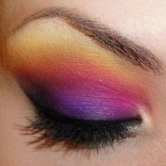 Purple Sunset. (use tape to make the defined smooth outer line from eyebrow to corner of the eye.)  1. Cream base. 2. Lilac eyeshadow on the whole lid. 3. Dark purple on the bottom of the eye lid, (closes to the lash line)