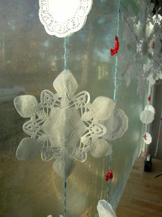 Make Hanging Snowflake Garlands (with doily and candy power!)