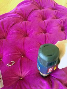 to speed up a tufting project, use a drill and screw to create the tufts and glue the button on top, instead of threading a button through the headboard.