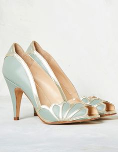 Isabelle is crafted from soft mint leather and finished with subtle metallic leather detailing throughout. Inspired by art deco accents, the petal shaped side panels connect at the centre to create… Bridal Sandals, Bridal Shoes, Bridal Footwear, Green Leather, Metallic Leather, Leather Heels, Leather Bag, Charlotte Balbier, 1930s Shoes