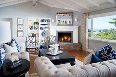 Contemporary Living Room with Jonathan adler - chippendale arm chair black, High ceiling, Laminate floors, Built-in bookshelf
