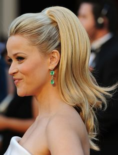 Reece Witherspoon does the volume ponytail. Very retro, 60's style. Big lashes are a must have with this look, and keep the rest of your makeup simple to let the lashes take force.