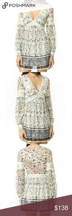 """🆕Free People Floral Embroidered Lace Mini Dress Woven, embroidered stripes complete the charming look of this mixed lace mini dress. Delicate pleats accent the skirt. Ivory lining. Button cuffs. Hidden side zip. Material: polyester shell/rayon lining. Approximate measurements: 33"""" shoulder to hem length,14"""" waist laid flat, 15"""" shoulder to shoulder, 18"""" armpit to armpit. Free People Dresses Mini"""