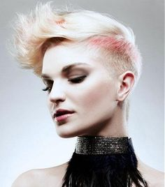 A short blonde straight coloured platinum spikey shaved-sides womens hairstyle by Mob Salons