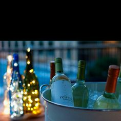 Wine bottles with lights used at my outdoor wedding reception