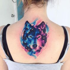 watercolor wolf tattoo with cosmic influences