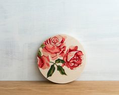 Celebrating the classic retro appeal of vintage paint by number imagery, with its endearing age-stained colors and distinctive graphic style. Our circle art blocks look great on their own or in a group. We love how the circular shape feels like looking through a porthole at the world beyond or a looking glass zooming in on a beautiful image. Prop them just about anywhere or hang with a single finishing nail - a small hole drilled in the back allows for easy hanging but these are also light…