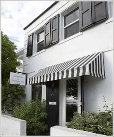 striped awning on white and black