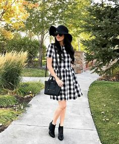 Black and white gingham dress. Floppy hat and ankle boots