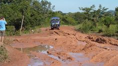 Aminah preparing to plough through the mud! (Photo from passenger Sally Crace) Overland Truck, Mud Bath, West Africa, Sally, Diving, Grand Canyon, Country Roads, Fun, Travel