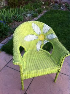 Resin wicker chair makeover.  From a weather worn seat to a sunny floral chair.