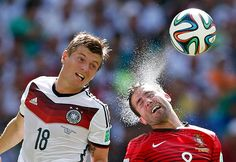 Credit: MARCOS BRINDICCI/REUTERS I'm not overly keen on what we call two-men-and-a-ball photographs, but this example of Germany's Toni Kroos vying for a header with Portugal's João Moutinho is another fine one. Funny what a few shimmering water droplets can do