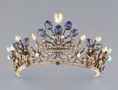 AN ANTIQUE PEARL, SAPPHIRE AND DIAMOND TIARA Designed as five graduating pearl and sapphire-set sprays and diamond-set scroll motifs, centring on a diamond-set marquise's coronet, mounted in silver and gold, with six brooch fittings, five hairpin fittings and a screwdriver, each spray and coronet detachable, circa 1880