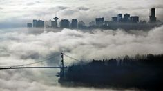 The downtown and Lions Gate Bridge enveloped in morning fog in Vancouver, British Columbia. (Reuters)