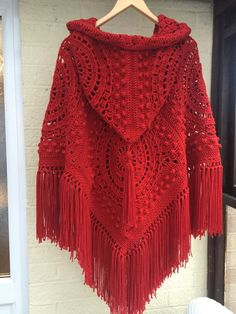 Handmade crochet hooded poncho with fringe and tassel in fabulous red. Seventies retro/vintage style poncho brought up to date with a hood