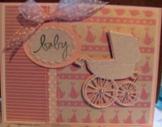 This card uses the Memory Box Baby Carriage die cut and papers from Reminisce.