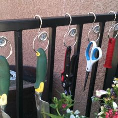 Even garden tools can have a little bling! I used 2 types of shower curtain hook. One plain round to attach to the tool and a fancy one to hang on the fence. Looks good and keeps tools handy.