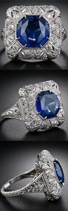 Sapphire and Diamond FIligree Ring, This striking, stunning and sizable early Art Deco sapphire and diamond ring highlights a bright and beautiful 4.50 carat royal blue Ceylon sapphire. The entrancing gemstone radiates from within a delicately milgrained octagonal setting enveloped in a sparkling cushion of diamonds, exotically adorned with a pierced stylized star motif.