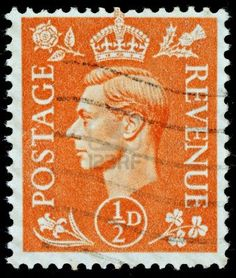UNITED KINGDOM - CIRCA 1950 to 1952: An English Half Pence Orange Used Postage Stamp showing Portrait of King George VI, circa 1950 to 1952