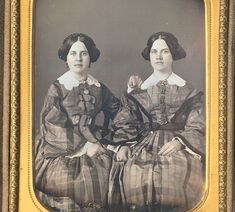 """Quarter plate daguerreotype of two sisters, taken for presentation to a friend circa 1856. Housed in a full case with some wear and leather-repaired spine Case inscribed in pencil behind image """"Presented to Lizzie H. Briggs, 8th of March 1856. / The likenesses of Sallie & L[ouey?] R. Th[om?] / Sallie in the 22nd year of her age L[ouey?] in the 20th. / Hainesport N.J. / Pine Grove."""""""