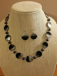 Check out this item in my Etsy shop https://www.etsy.com/listing/497576420/ombreblack-coin-shell-beads-w-silver