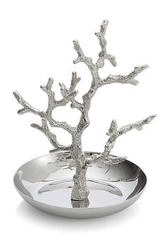 Cool idea! Spray paint any found object, coral, branches, etc using Krylon looking glass spray paint and hot glue to small glass dish to display rings and pendants etc.