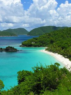 St. John. I remember this exact view in my memories  driving over the mountain top to see this beautiful beach that we got to snorkel off of  saw my first barracuda here.