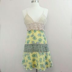 Free People paisley and crochet sundress Lightweight sundress.  Cream bust with crochet,  ruffle and ribbon details.  Skirt has alternating paisley and floral patterns.  Fully lined.  55% linen, 45% cotton. Free People Dresses